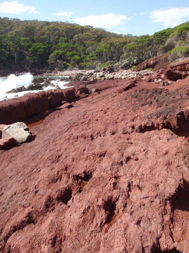 Red rock in red sands bay