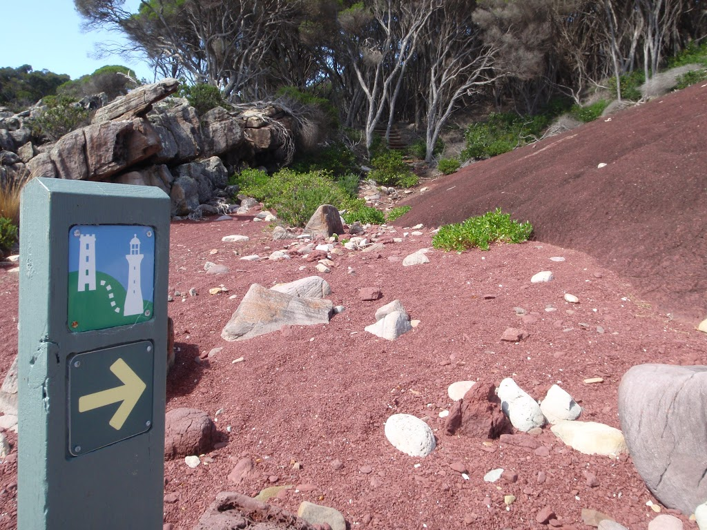 Arrow marker in red sands bay