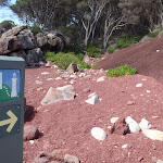 Arrow marker in red sands bay (103069)
