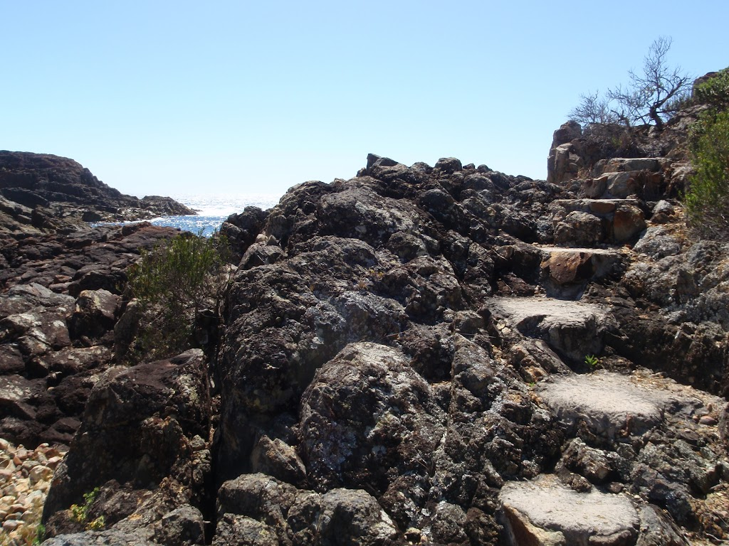 Stairs out of rocky beach