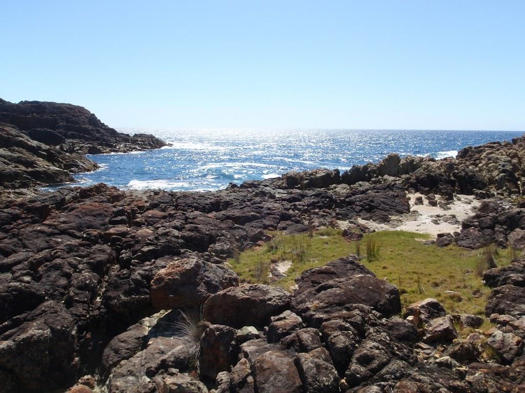 Grass platform south of rocky bay