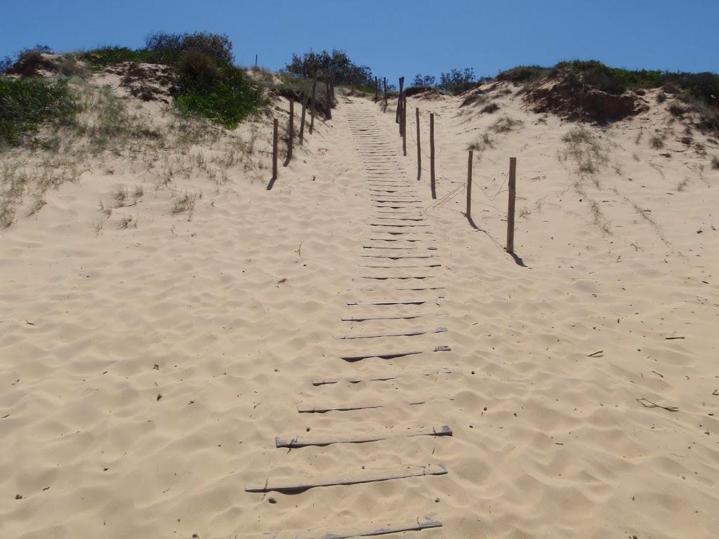 Track down dunes onto Wallagoot Beach