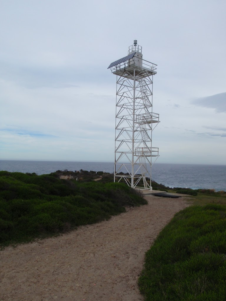 White metal tower below Green Cape Lighthouse