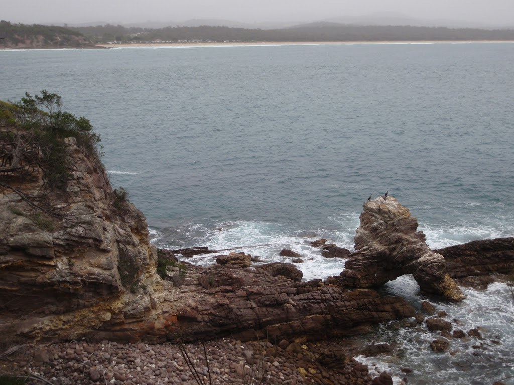 Arched rock with Pambula Beach in background