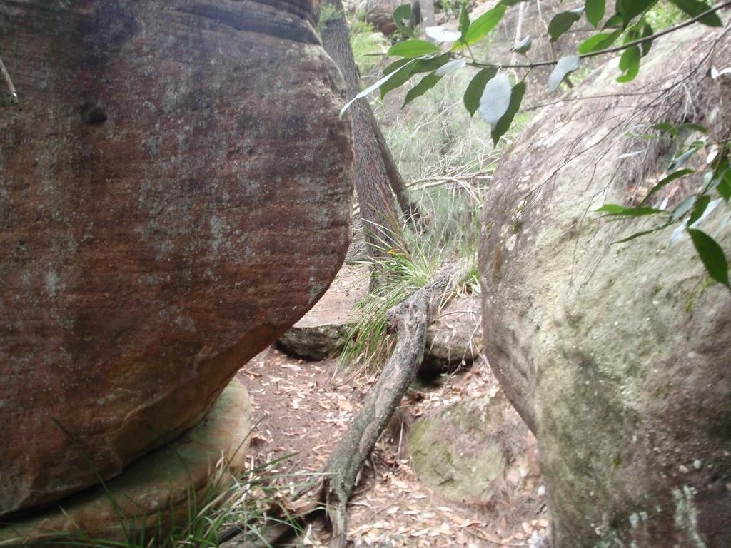 Passing between some boulders
