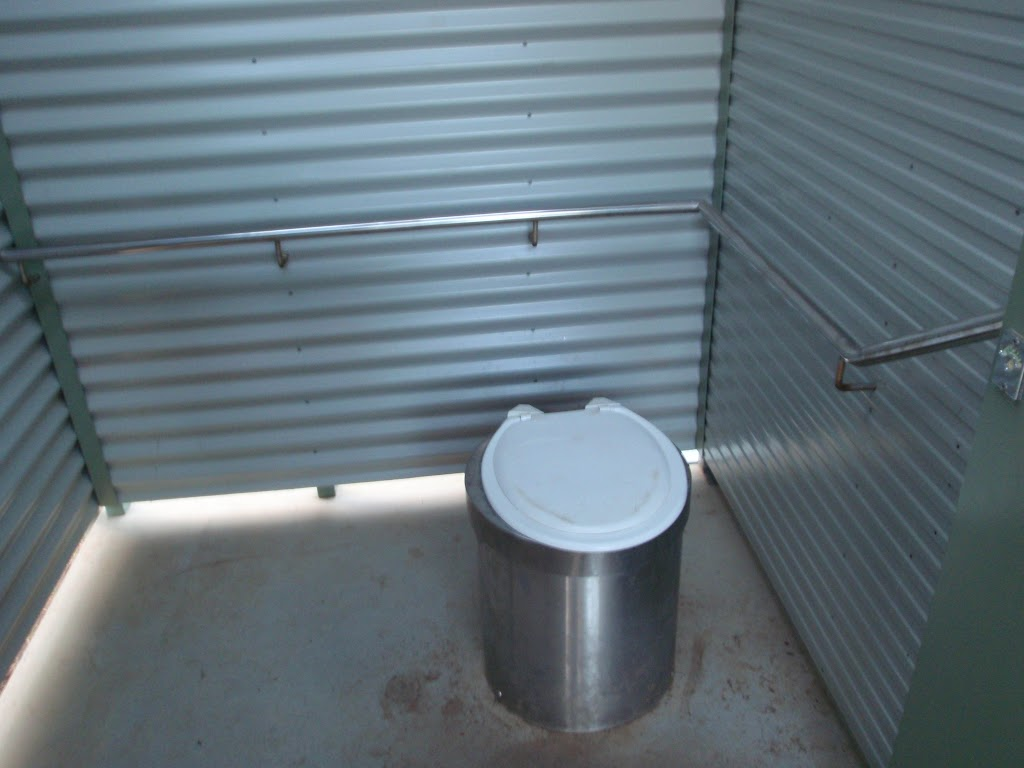 Pit toilet with hand rails