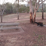 There are several picnic tables and fire places