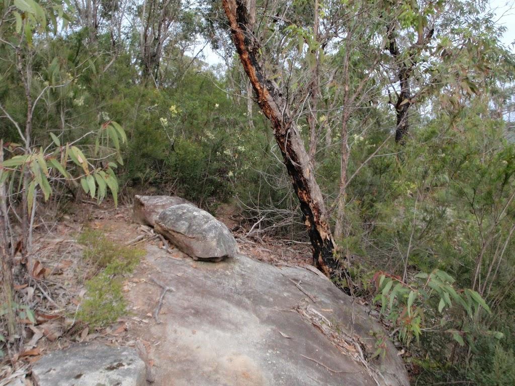Attic Cave track crossing rock