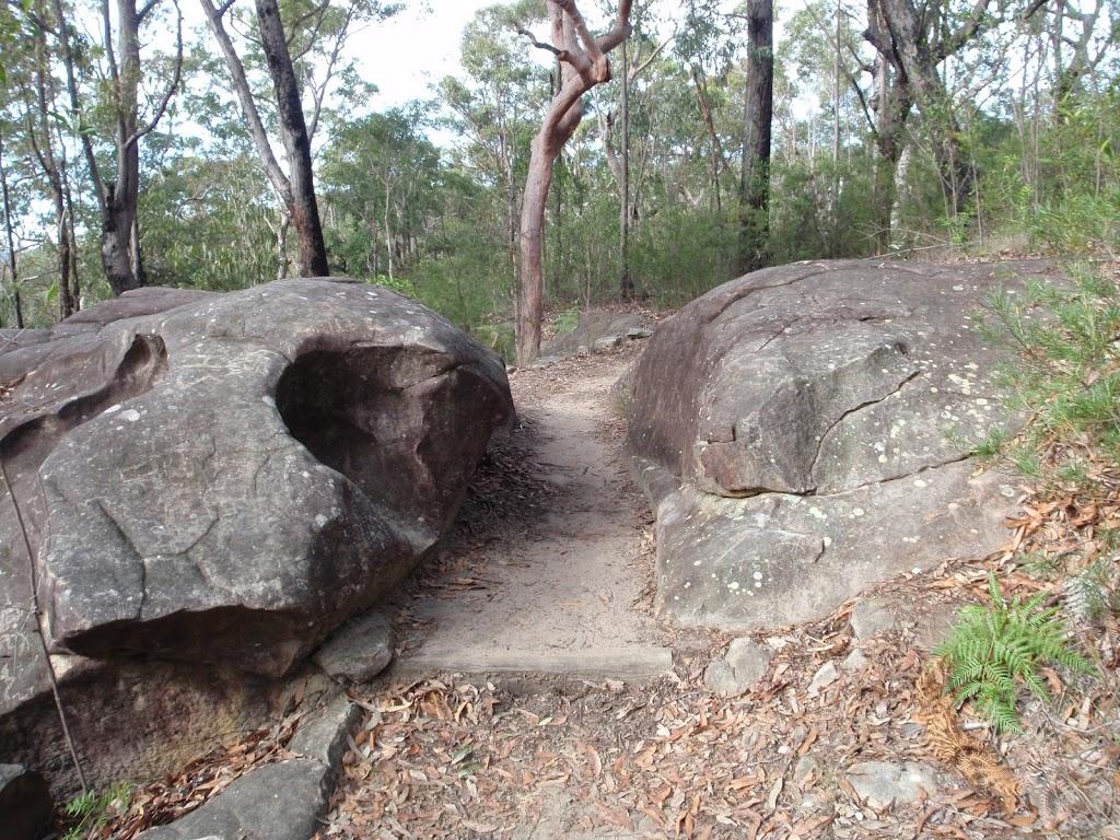 Walking between boulders towards Red Hands Cave