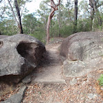 Walking between boulders towards Red Hands Cave
