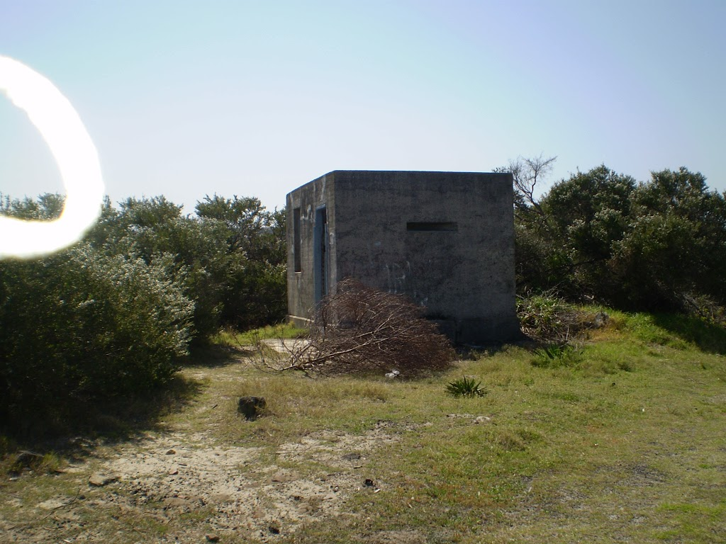 Historic concrete building on coast cemetery trail
