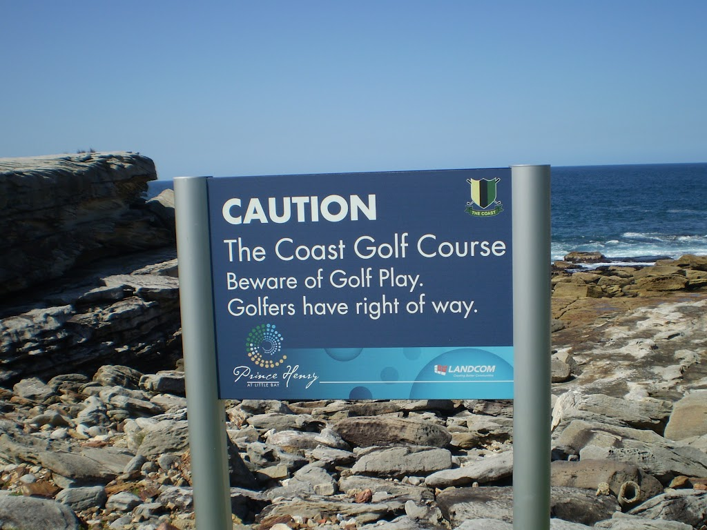 Caution sign about golf near Little Bay