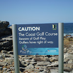 Caution sign about golf near Little Bay (18018)