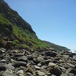 Imposing hills and boulder strewn coastline (207175)