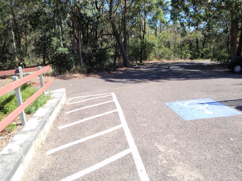 One of a few carparks next to the mud brick building