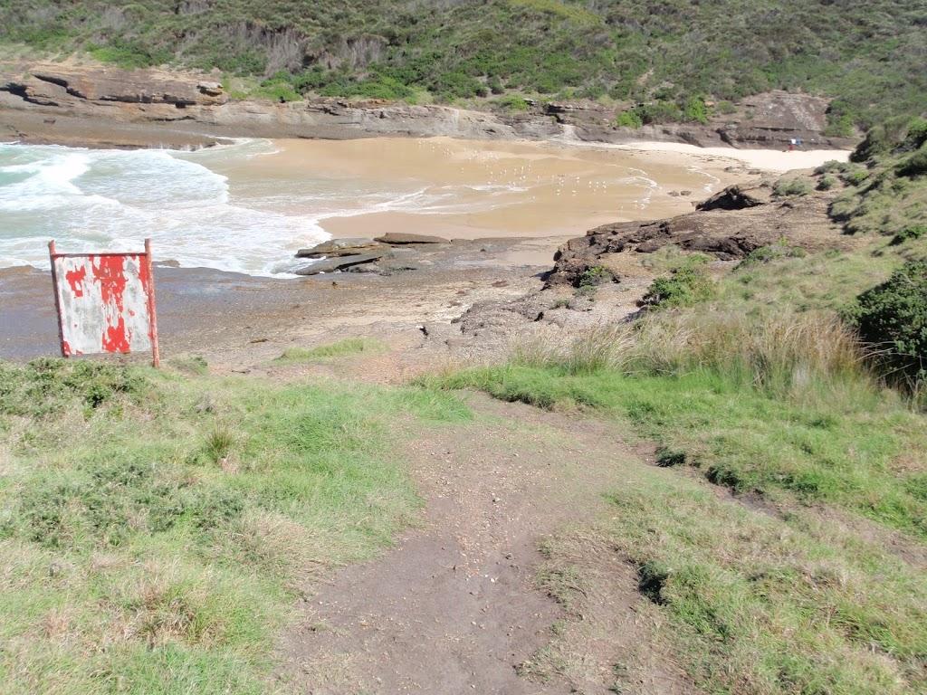 Looking across rocks to Snapper Point beach