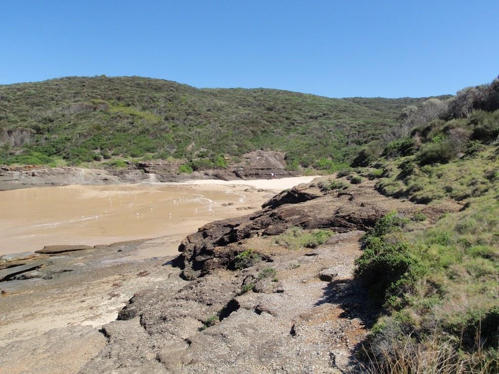 Crossing rocks on the eastern side of Snapper Point beach