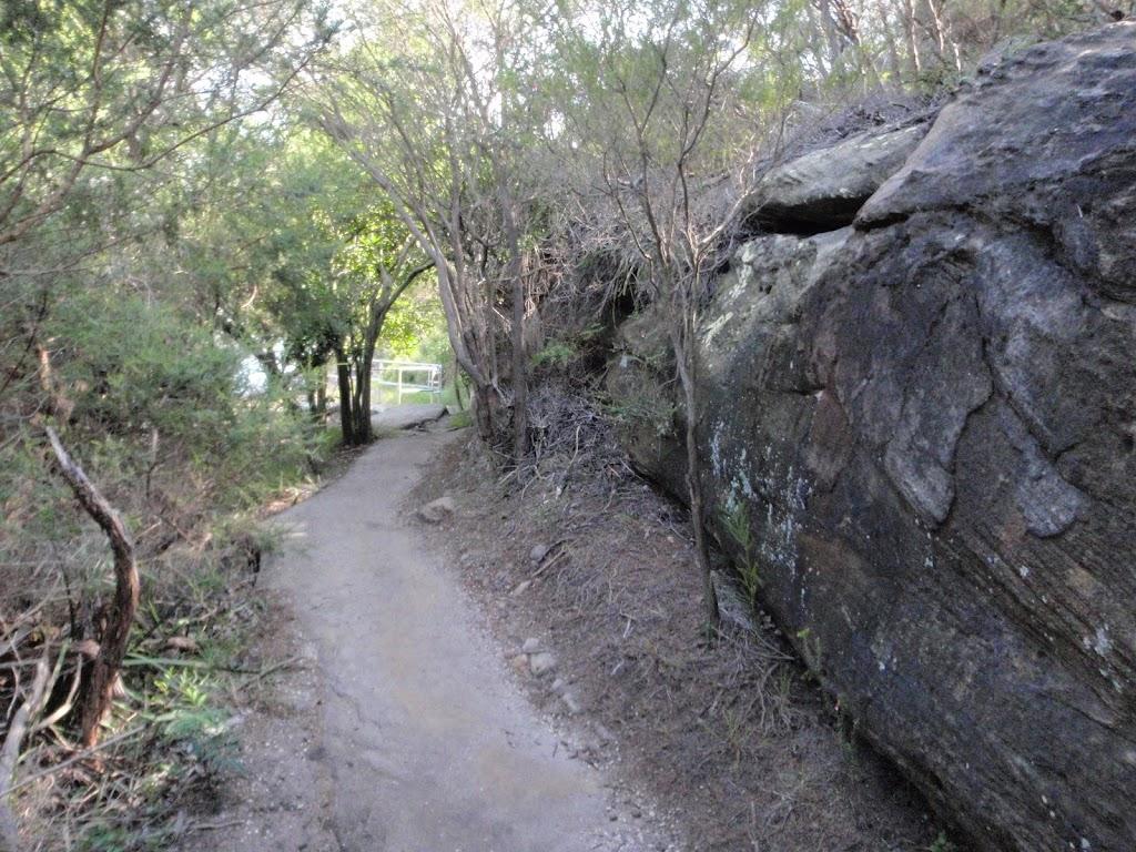Walking beside rock wall