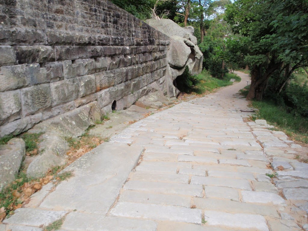 Sandstone wall and old Cobblestone Rd