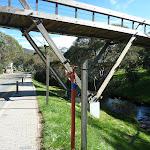 Walking under foot bridge on Friday Dr (273800)
