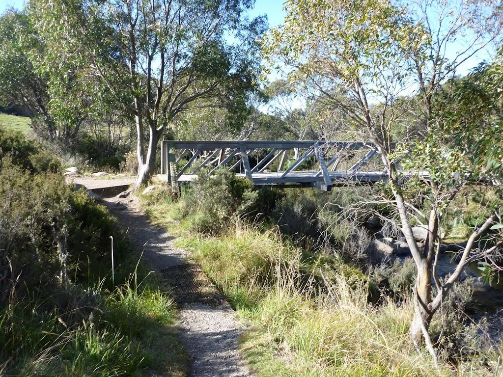 Riverside track passing foot bridge