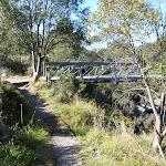 Riverside track passing foot bridge (274022)