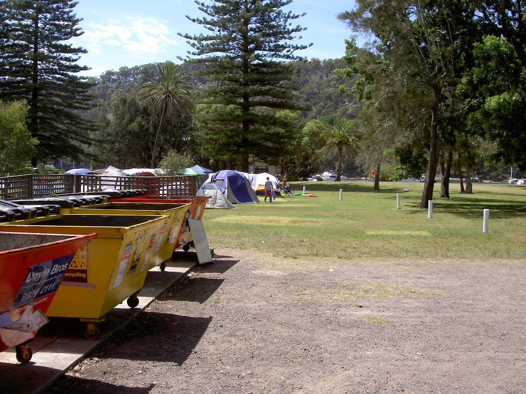 The Basin Campground Dumpsters. White posts to wharf