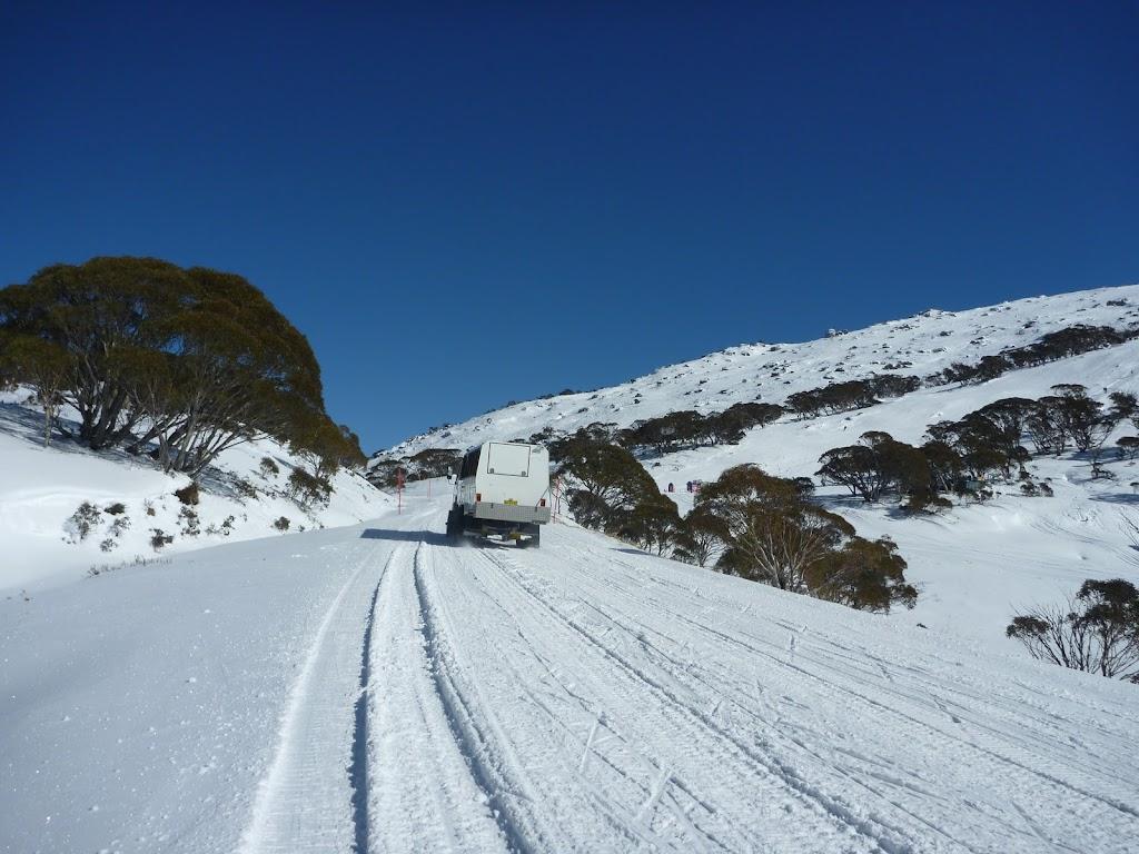 Oversnow transport on Kosciuszko Road in winter