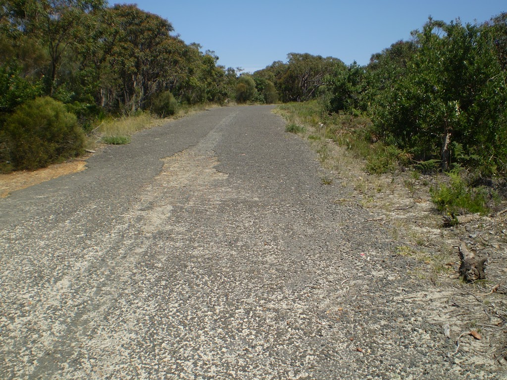 The gravel rd at the end of Beachcomber Rd