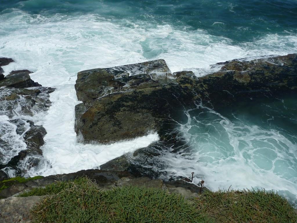 Waves crashing against rocks at Bogey Hole