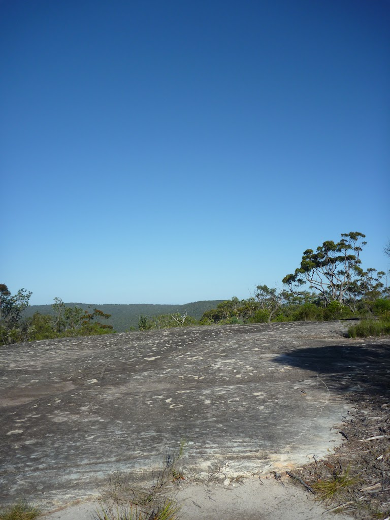 Crossing a large rock platform in Brisbane Waters National Park