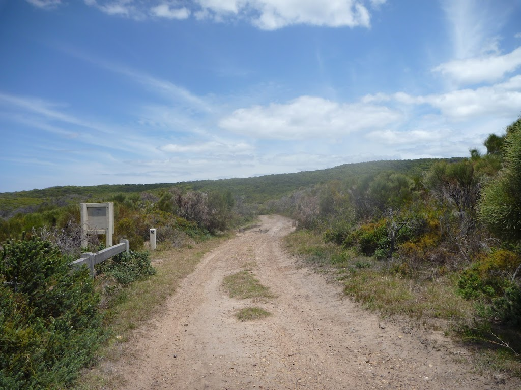 Trail with signage on Pinney's Headland in Wallarah Pennisula