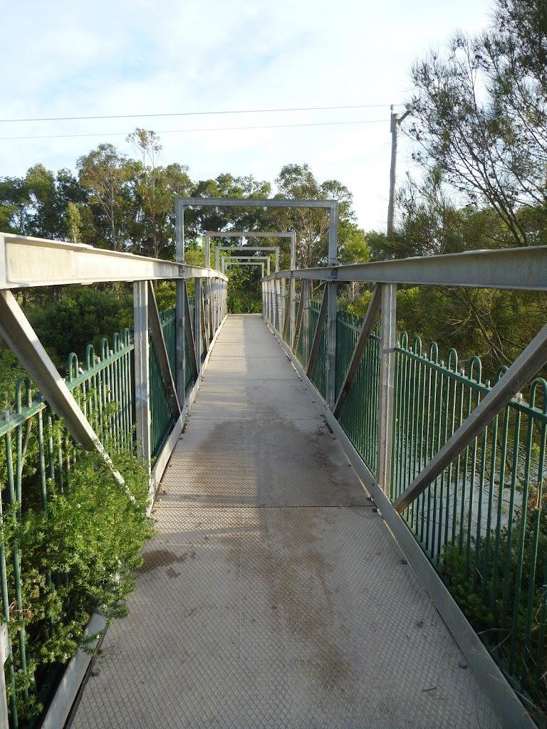Metal foot bridge over creek at Belmont Lagoon