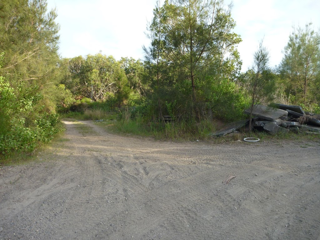Spit walk and large pile of concrete at Belmont Lagoon