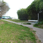 Foot path and metal seat near the Owens Walkway Car Park in Redhead