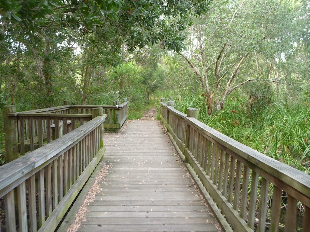 Timber bridge with seating over Owens Creek in Redhead