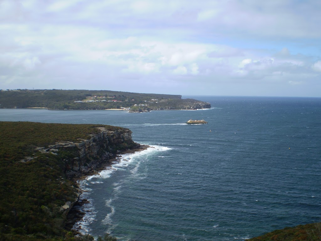 A Manly Ferry breaking past the heads