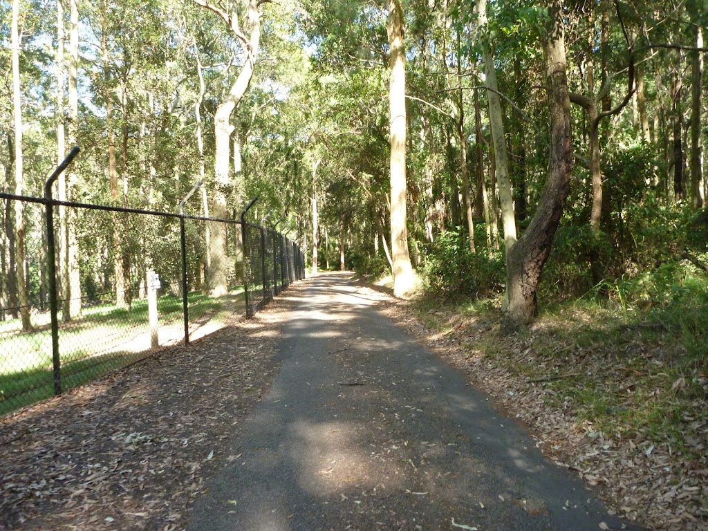 Metal ring fence beside a sealed trail in the Blackbutt Reserve
