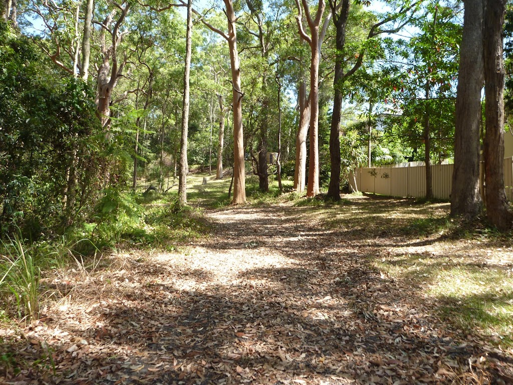 Trail with house visible in Blackbutt Reserve