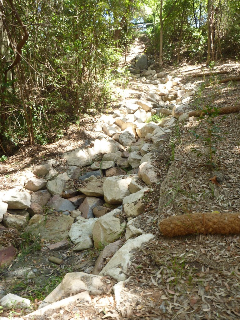 Rocky dry creek bed with bridge in Lily Pond Picnic Area in Blackbutt Reserve