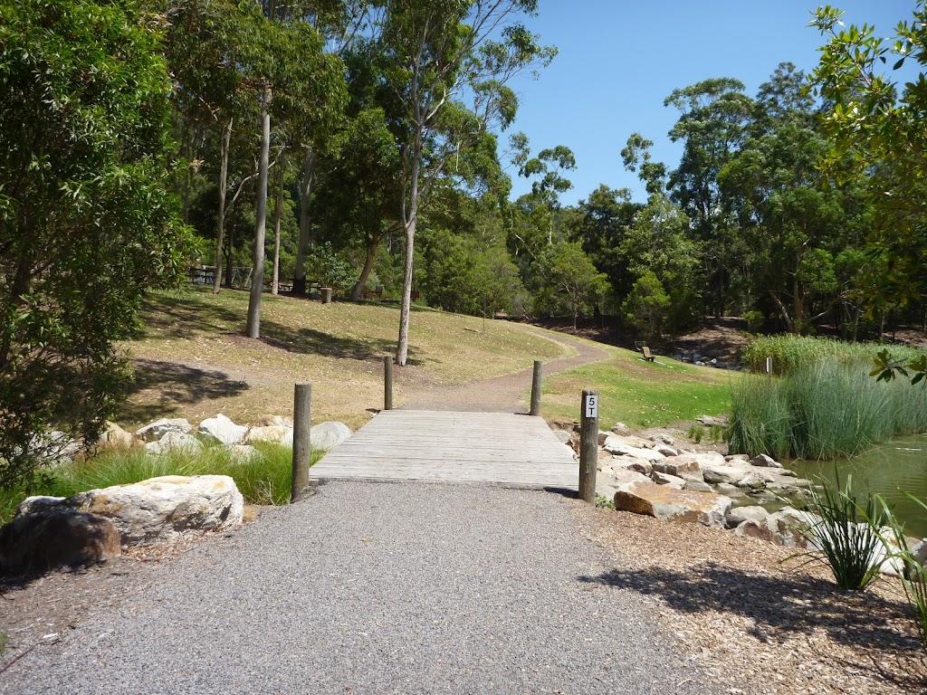 Timber bridge over creek in Richley Reserve in Blackbutt Reserve