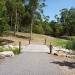 Timber bridge over creek in Richley Reserve in Blackbutt Reserve