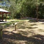 Sign and sheltered picnic tables in Richley Reserve