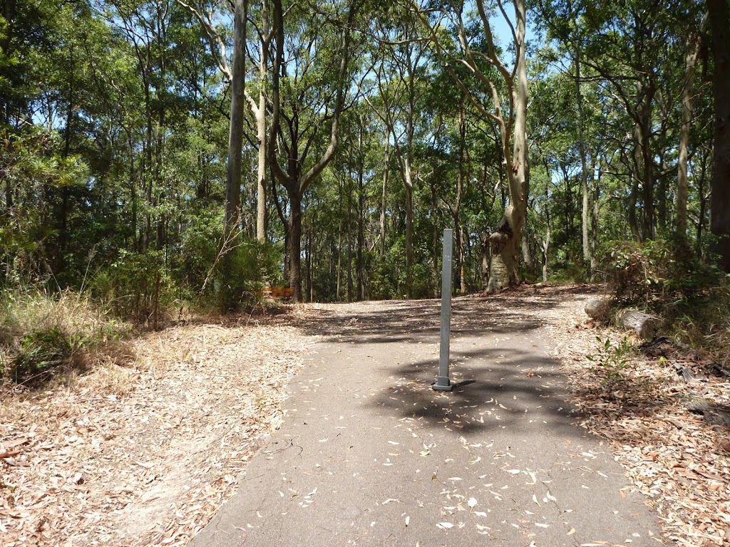 Sealed trail with metal post near Richley Reserve in Blackbutt Reserve