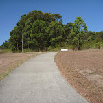 Open grasslands next to a path in Green Point Reserve (402910)