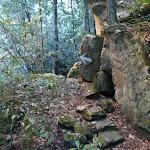 White arrow through boulders (52214)