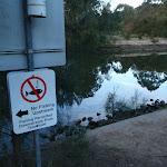 Sign below weir