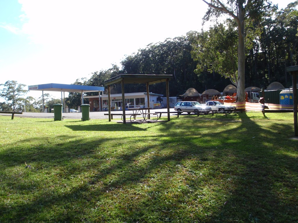 Grassy area beside motel and petrol staion