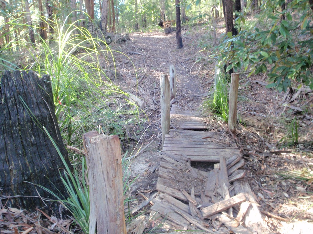 Old broken timber bridge on the track towards Abbotts Falls in the Watagans
