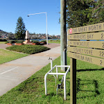 Great North Walk sign post, pointing to; Newcastle, Warners bay, Sydney Cove and Teralba Rail